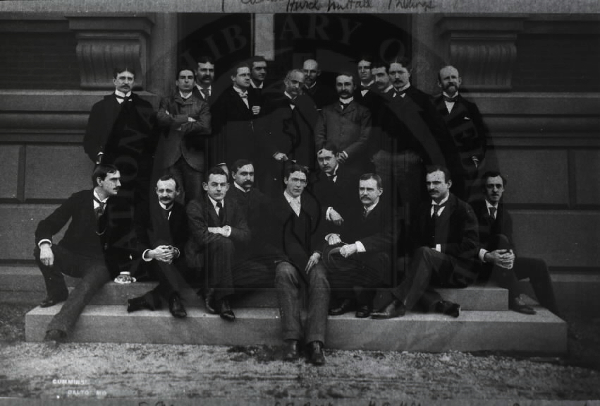 What the family looked like in 1892. Baltimore: Cummins,1892. 1 photomechanical print :photogravure; 21 x 14 cm. The Johns Hopkins Medical Class of 1892 and staff seated outside on steps of a building. In the foreground, left to right: W.W. Russell, Simon Flexner, O.G. Ramsey, R.R. Smith, L.J. Barker, Eugene M. Van Ness, H.A. Kelly, John G. Clark, and Rupert Norton. Back row, left to right: W.H. Baltzell, John Hewetson, J.M.T. Finney, A.L. Stavely, T.S. Cullen, Henry Hurd, W.S. Halsted, G.H.T. Nuttall, William Thayer, Hunter Robb (?), John Sedgewick Billings, and B. Lanier. Portrait no. Group 55-2 Old Negative no. 66-203 Johns Hopkins Medical Institutions. School of Medicine. Title taken from caption.. Images from the History of Medicine, Order No. B011682. National Library of Medicine