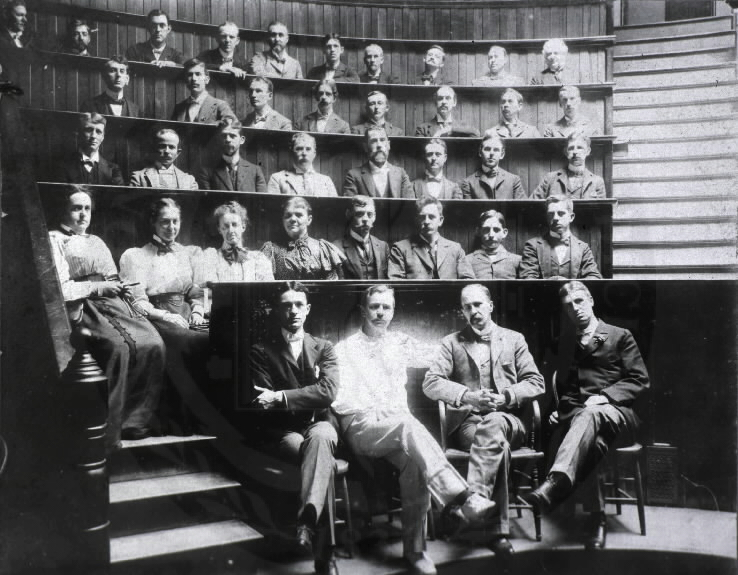 Johns Hopkins Medical School. Photograph of graduating class. Baltimore ,[between 189- and 191-]. Group portrait of unidentified Johns Hopkins Medical School graduating class with (left to right) professors Harvey Cushing, Howard Kelly, Sir William Osler, and William S. Thayer seated in foreground. Images from the History of Medicine, Order No. B011683. National Library of Medicine