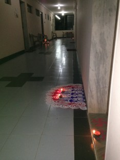 Puntis or oil lamps diwas are placed in the rangoli at the threshold of the house. Here it's at the threshold of each of the residents' rooms in the old peoples' resort.