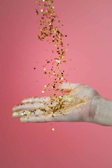photo of confetti on person s hand