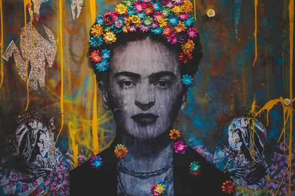 creative graffiti wall with portrait of frida kahlo