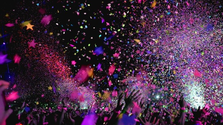2020 New Years Eve Party concert with colorful confetti in the air