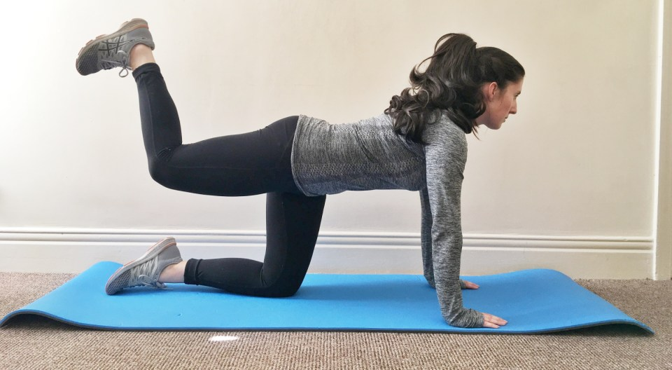 Charlotte from Take a Paws doing yoga on a blue mat, showing how her relationship with exercise changed after ditching the diet culture.