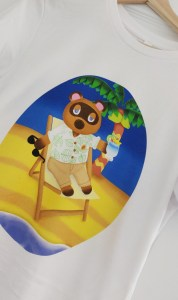 White t-shirt with Chloe's Animal Crossing Merchandise Tom Nook Design