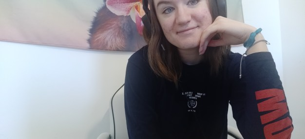 Me sat smiling at camera.
