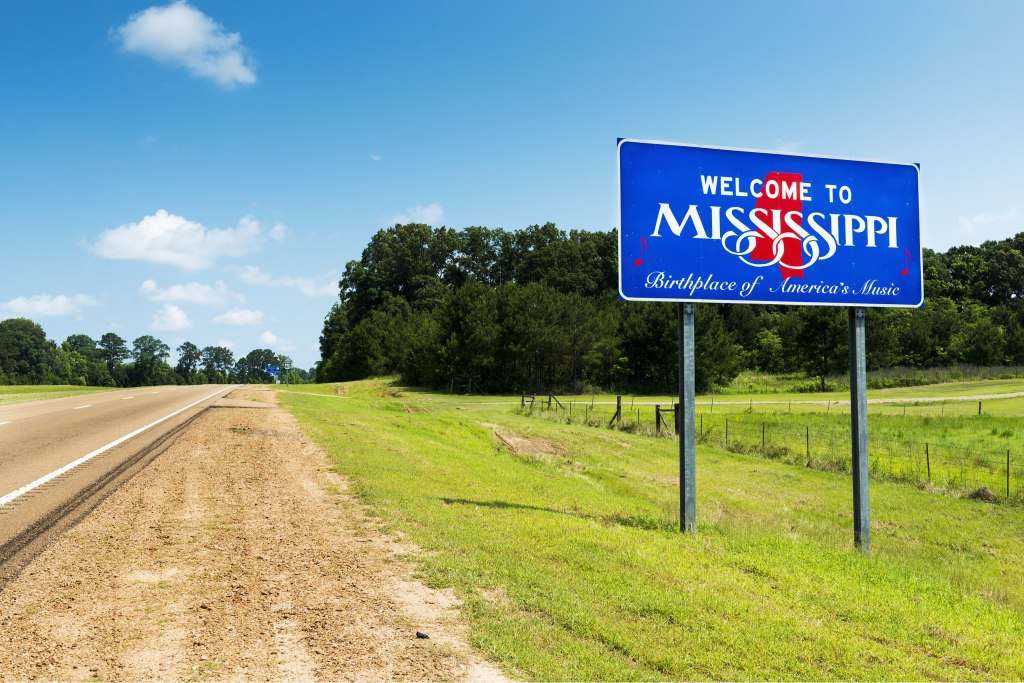 "Mississippian ""Welcome to Mississippi"" street sign on the side of the road."