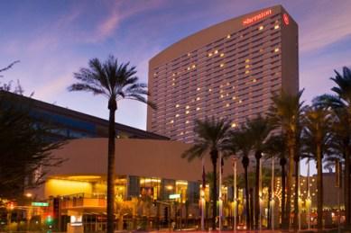 photo of exterior of large Phoenix Sheraton hotel lit up at twilight