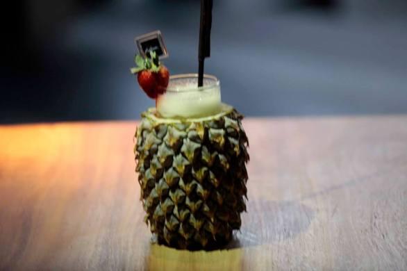 TROPICANA - Malibu, Midori, Banana Liquor, Fresh Lime, & Pinneapple Juice