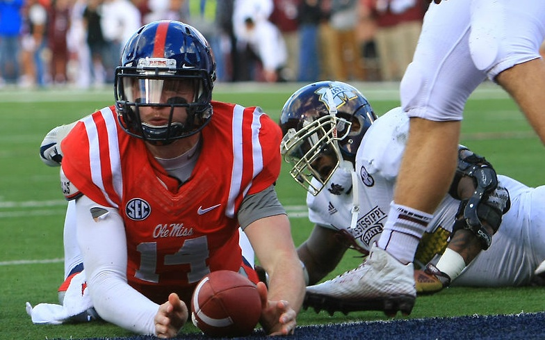 Bo Wallace, despite a bum ankle, struggled for every inch in a courageous Egg Bowl performance.