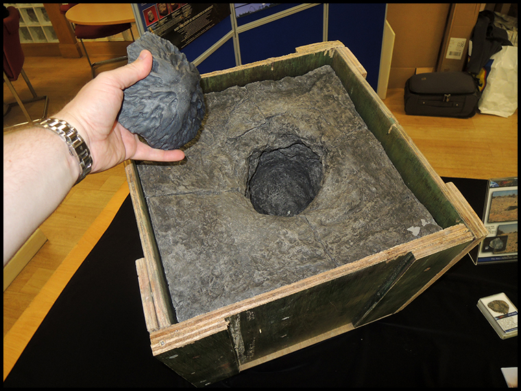 A cast of the amazing oriented Middlesbrough meteorite with a cast of the impact that it made in 1881 when it fell
