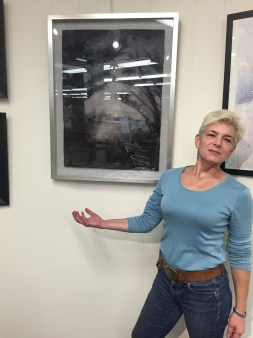 Committee memeber Orna Greenberg in front of her watercolor