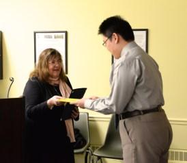 Qizhang (Victor) Wu receives his scholarship award