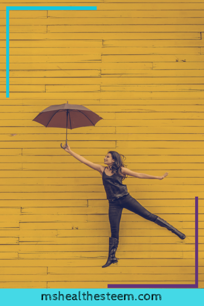 A woman jumps in the air with an umbrella, caught in a moment that makes it appear as if she's flying.