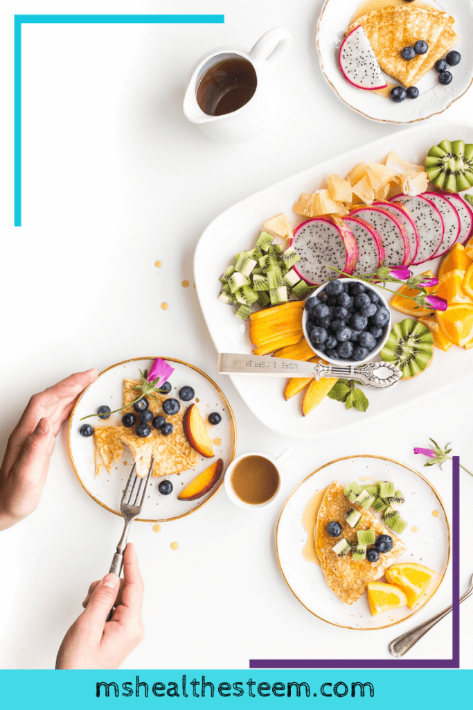 Someone enjoys a platter of different breakfast foods, including crepes, maple syrup and lots of fruit. Creating a healthy, balanced diet is an important healthy lifestyle habit.