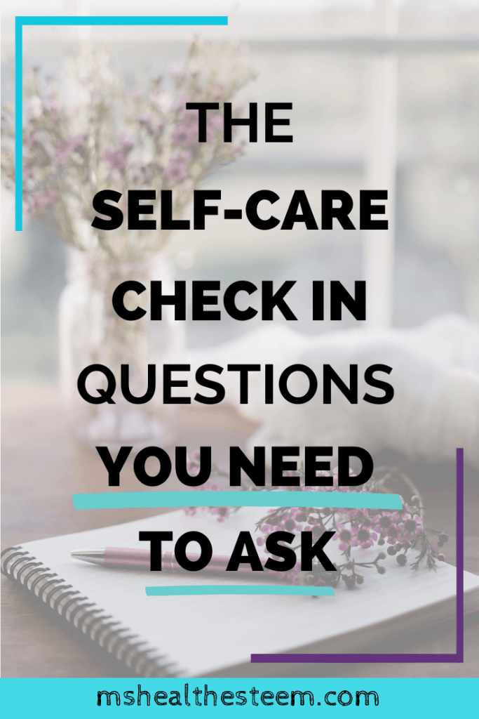 The Self-Care Check In Questions You Need To Ask Title Photo. In the background A journal sits open on a table, with purple flowers and a pen on top. Behind the journal there's a vase with purple flowers in it and a white blanket that sits bundled on the edge of the table.