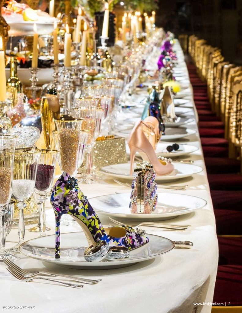 Gorgeous table setting of heels and handbags.