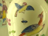 Fly between birds on a vase