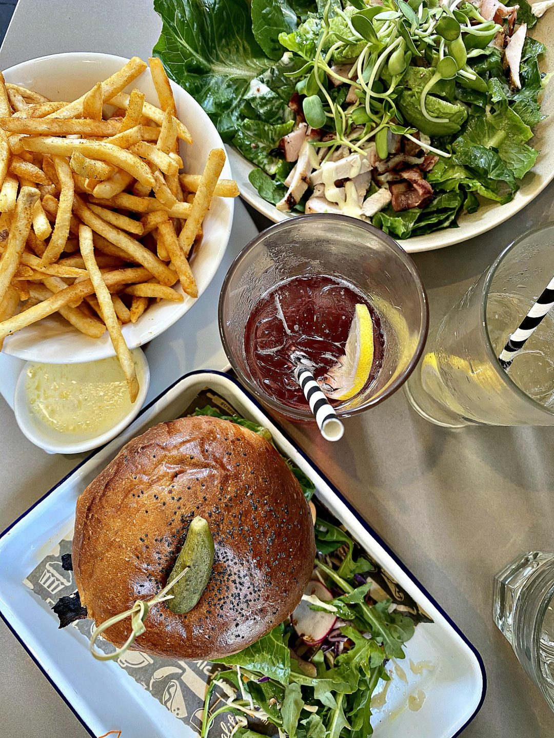 A picture of burgers, fries and salad from butcher, baker, bangalow. Guide To Spending A Day In Bangalow.