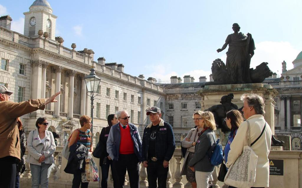 Picture of a group of people getting a tour of Somerset House.  Free Tours Of London Buildings.