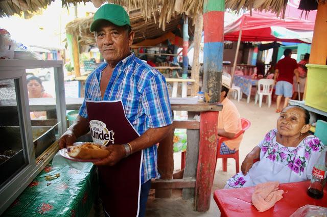 jose and alexandra make cochinita pibil,  holbox,yucatan, mexico