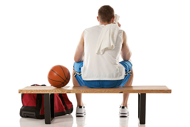 Rear view of a basketball player sitting on benchhttp://www.twodozendesign.info/i/1.png