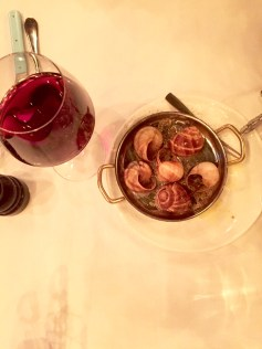 Escargot with butter and truffles.