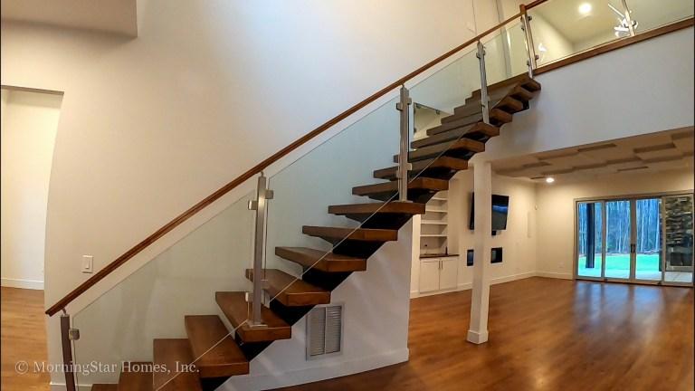 Custom Mono-Stringer Open Staircase with Glass Handrails