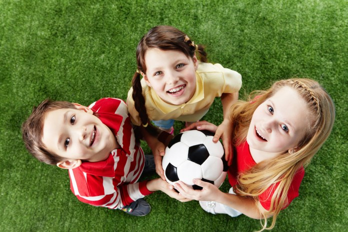 Children-2-girls-and-boy-with-football-ball