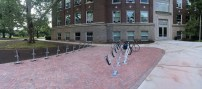 Pan of new bike parking area in front of Olds Hall.