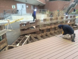 Installing the new marine-grade coated aluminum decking.