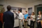 Participants look at a poster explaining robotic fish.