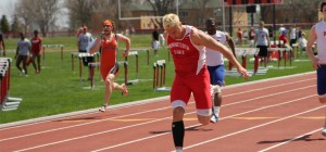 Senior Derek Bredy runs in a home meet for the Dragons. Photo courtesy of Dragon Athletics