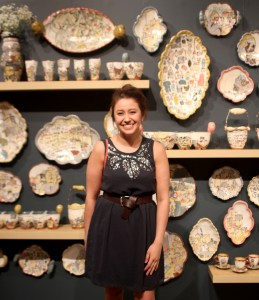 Catherine Miller stands with her 65 ceramic pieces.