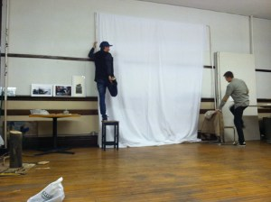 Dustin Snyder and Noah Kupcho set up their studio for a photo shoot.