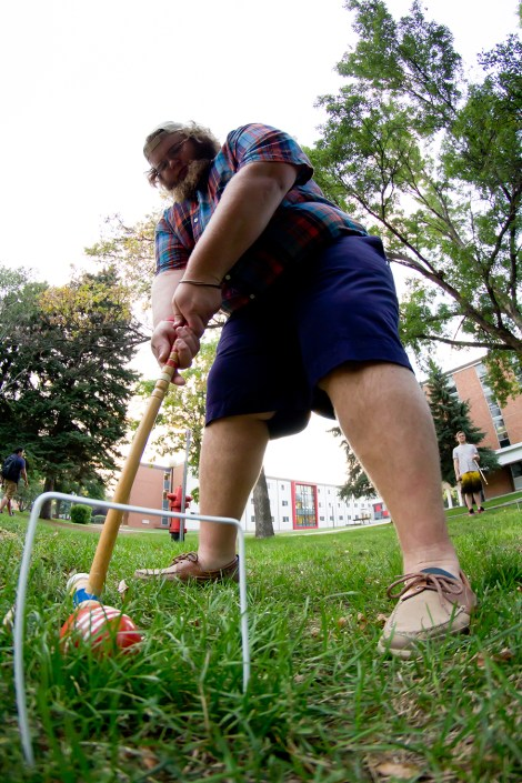 """Undeclared sophomore Adam """"Grizzly"""" Lang plays croquet Wednesday as a part of the Kappa Sigma fraternity's first rush week ever. MSUM's only fraternity, which was chartered last year, held events throughout last week."""
