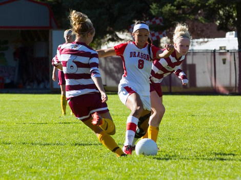MSUM's Stephanie Lindo goes for the ball in NSIC action Sunday in the Dragons home opener. The Dragons lost in overtime to Northern State 1-0.