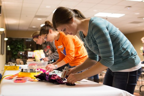 """MSUM students gathered Oct. 16 in the CMU to decorate bras for this Friday's """"Bras on Broadway"""" event. Left to right: Morgan Smith, elementary education sophomore, Carly Peterson, elementary inclusive education senior and special education senior and Becca Ryan, speech pathology junior."""