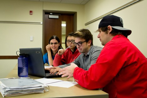 Social work students plan community outreach efforts Thursday night in Lommen. Adjunct social work professor Tim Erhardt's class focuses on increasing awareness of homeless youth in the Fargo-Moorhead area.