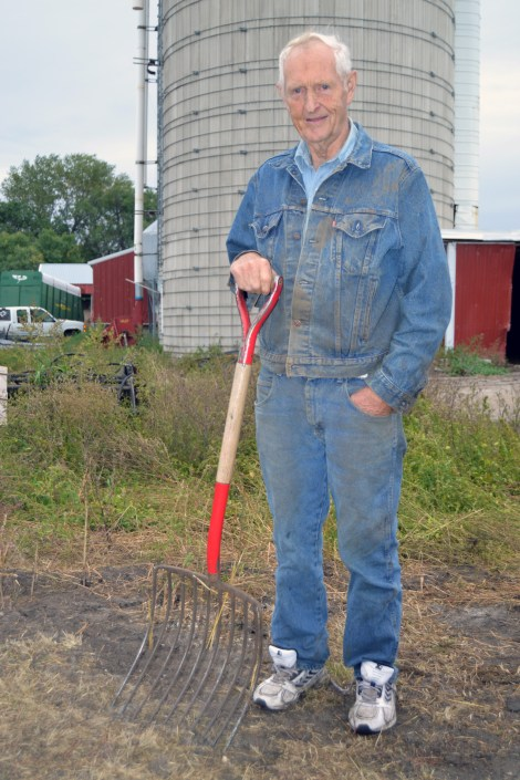 Former Sen. Keith Langseth takes a break from pitching manure at his farm south of Glyndon.