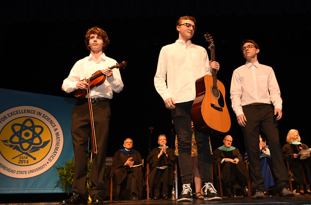 Levi Hoskins, (19), Evan O'Neill (20) and Josh Loiacono (20) played accompanying music for Embury at the Craft Academy commencement.