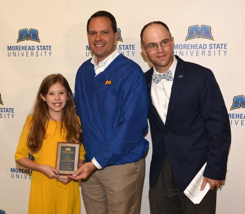 Maddie Rae Wells (left) accepted the Notable Alumni Award on behalf of her father Jesse Wells (08).