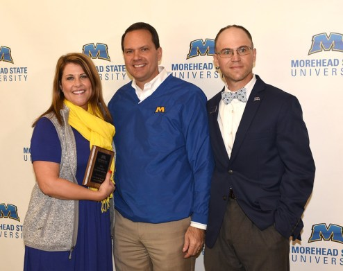 President Jay Morgan (center) and Jason Marion (04, right), president of the MSU Alumni Association, present the Notable Alumni Award to Gena Boyle Burger (04).