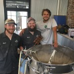 From left: Nicholas Hollan, Blake Nickell and Derek Caskey first had the idea to open Sawstone Brewery after getting involved with home brewing.
