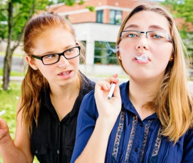 Teen Girls Vaping In High School Parking Lot