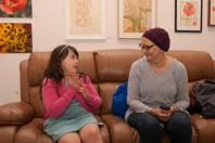 """Opening of the """"Flowers, Flores, Ubaxa"""" exhibition at the Mount Baker Neighborhood Center for the Arts. Lucinda Dempster talks with crochet artist Nona Smith."""