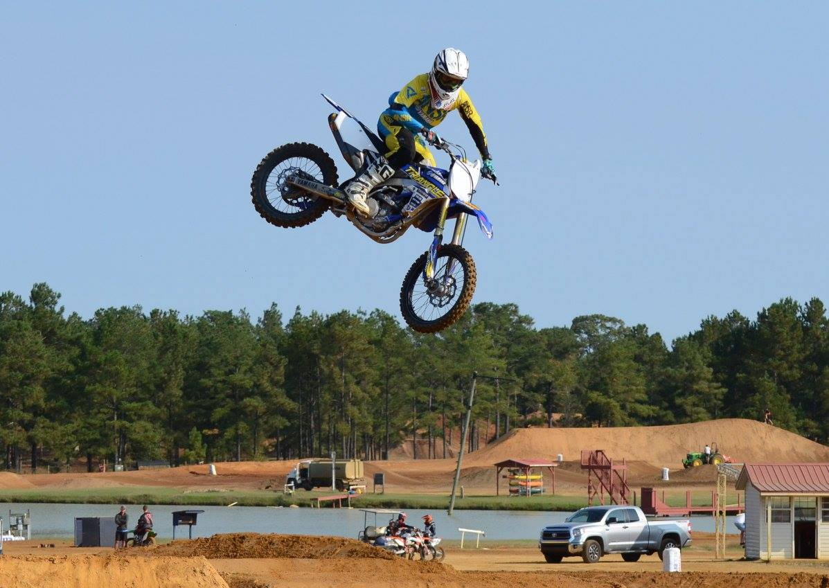 Rider flies through the air on a motocross jump at the track