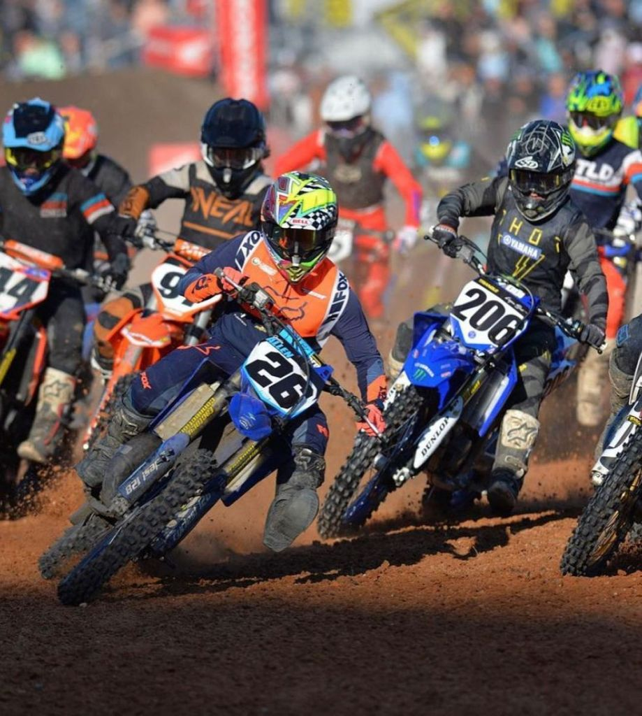 Justin Allen, number 26, rounds a corner at the lead of the pack at a Daytona Amateur Supercross race.