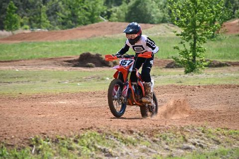 Gabe Fink races through the straightaway on the motocross track
