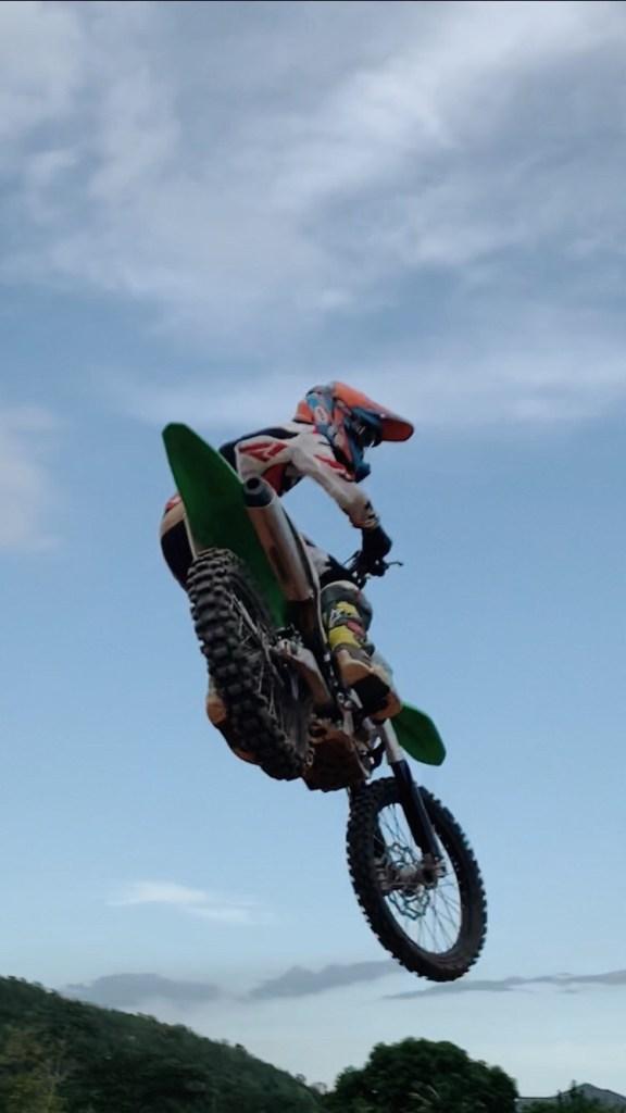 Simon Khouri whips over a tabletop on the motocross track.