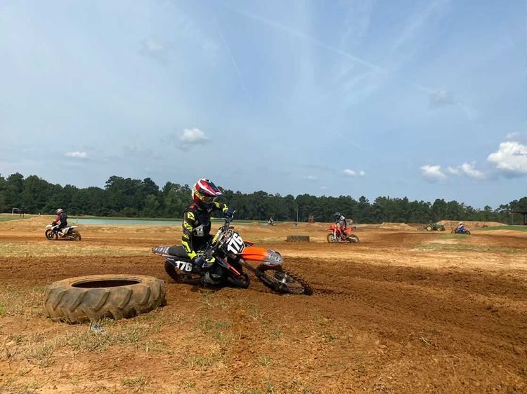 Max Jordan rides through a rutty corner on the motocross track.